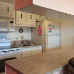 Our kitchen with full size fridge, stove & microwave